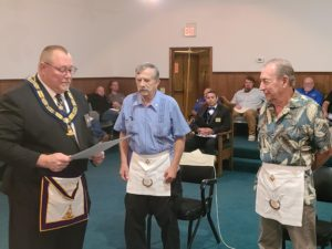 WB Wiley Forrester presenting the 50 year award to brother Ed Starburg and to brother Blake Bagwell