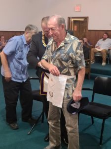 Brother Blake Bagwell receiving his 50 year apron.