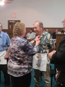 Br. Blake Bagwell receiving his 50 year pin by his wife.