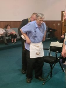 Br. Ed Starburg receiving his 50 Year Apron. WB Wiley Forester presenting