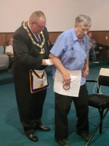 Br. Blake Bagwell receiving his 50 Year Apron. WB Wiley Forester presenting.