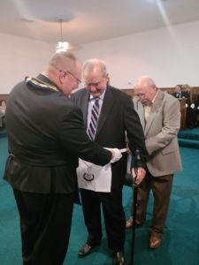 WB Warren Banks (assisted by WB Wiley Forester) presenting the 60 Year Apron to his Uncle, Br. Fred Banks